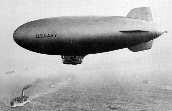 A U.S. Navy helium-filled K-class blimp was 230 feet long. It's crew of 10 could patrol stay aloft for 38 hours travelling at a cruising speed of 58 mph.