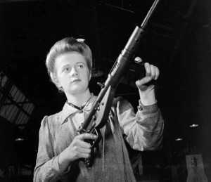 A factory worker shows off a new Sten gun. (Image source: WikiCommons)
