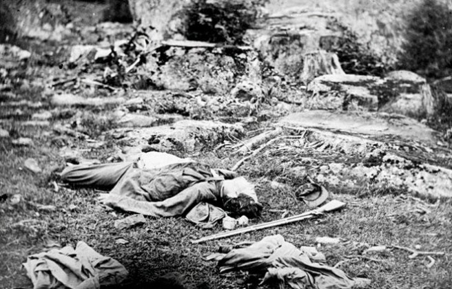 "Alexander Gardner's famous Gettysburg picture ""A Sharpshooter's Last Sleep"" features a corpse that looks a lot like the body in another photo taken elsewhere on the battlefield. Did Gardner move the corpse?"