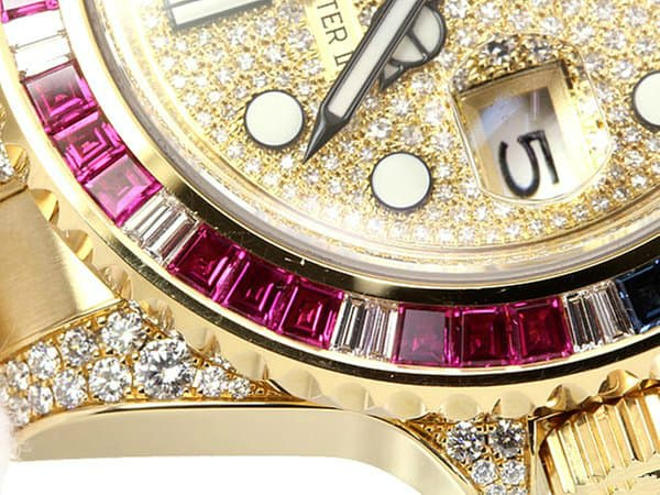 Rolex GMT with factory diamonds and rubies