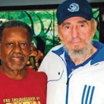 Rev. Lucius Walker is pictured with former President Fidel Castro of Havana, Cuba. The two had become friends throughout the years from Walker's numerous humanitarian visits to Cuba. This photo was taken in 2009.