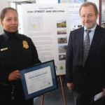 Captain Edith Hudson of Milwaukee Police District 5 accepted an award that recognizes the King Drive Partners and Milwaukee Police Department from the MetLife Foundation Community-Police Partnership last week. The honor recognized the reduction of crime and the spurring of lasting economic development along the historic Dr. Martin Luther King Drive in downtown Milwaukee. Presenting the award on behalf of MetLife is Leo Ries, executive director of Local Initiatives Support Corporation (LISC) Milwaukee. This national award is sponsored by MetLife Foundation and administered by LISC. This partnership was chosen from 700 applicants.(Photo by Robert A. Bell)