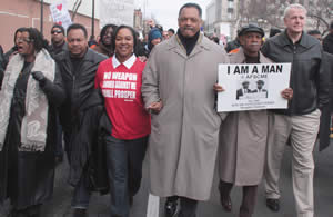 "Rev. Jesse Jackson, along with Congresswoman Gwen Moore, State Senator Spencer Coggs, State Senator Lena Taylor and Milwaukee Mayor Tom Barrett led a march last Saturday from King Drive to Arrow Park to encourage early voting. The purpose of the march organized by the Milwaukee NAACP themed, ""March Fit For a King"" was in honor of Dr. Martin Luther King, Jr.'s 43rd Assassination Anniversary was on April 4th. Hundreds of people participated in the march. Marchers waived signs reading, ""This is what democracy looks like,"" ""Save our unions and collective bargaining,"" and ""Stop the attacks on public sector workers."" (Photo by Robert A. Bell)."