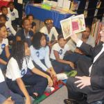 Paul-Krainiak-Discovery-World-executive-director-reads-to-children-Be-A-Reader-tour-Milwaukee-Academy-of-Science