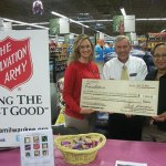 Pick-N-Save-Roundys-foundation-representatives-presenting-check-to-Salvation-Army-Milwaukee-County-accepting-is-Faithe-Colas