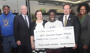 Pictured at the check presentation above from (l-r) are: Will Allen, Growing Power CEO, Mayor Tom Barrett, Bradley Tech teacher, Rochelle Sandrin, Bradley Tech student, Odell Chambers, AT&T WI president, Scott VanderSanden and MPS STEM director, Lena Patton. (Photo by Robert A. Bell)