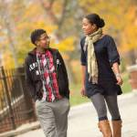 UWM student and mother Chanel Edwards walks alongside her son