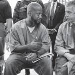 Education-Secretary-Arne-Duncan-speaks-participant-Goucher-College-Prison-Education-Partnership-Maryland-Correctional-Institution-cropped