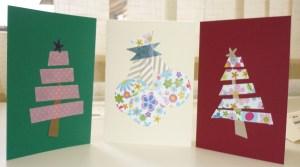 Foto de tres postales navideñas hechas con whasy tape