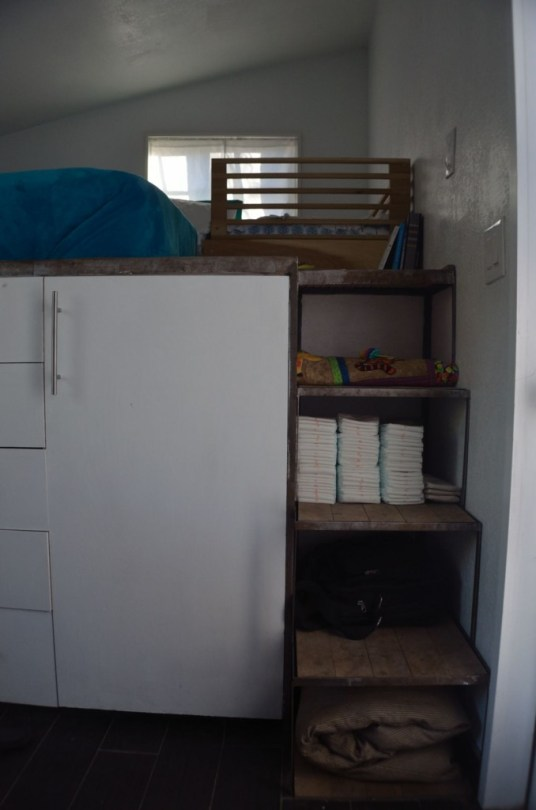 I am going to go through SOME of my storage spaces and be completely transparent about how messy/tidy I am... starting with the stairs, these are slightly staged for the shoot, generally there is the dog bed rolled up on the bottom shelf (except when it's out on the floor with the dog on it... my computer on the second, Diapers on the third and a couple pairs of shoes on the top shelf...