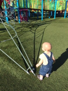 played at a cool playground where she discoved slides, aka the coolest thing ever, she could slide all day!