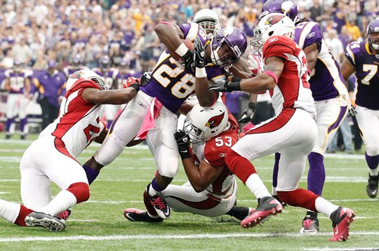 Photo of Adrian Peterson Plowing In For A Touchdown Against The Arizona Cardinals