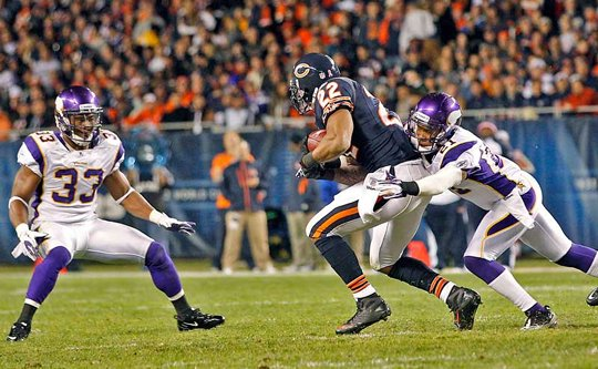 Photo of Matt Forte running against Asher Allen and Jamarca Sanford
