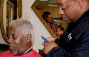 At Womack Salon Academy, Barber Scott Womack gives his uncle, Larry Womack, a free haircut.