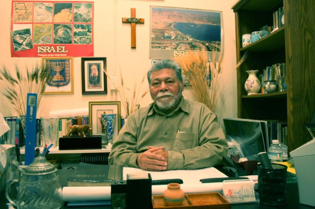 Miguel Castro at his desk at El Santo de Israel