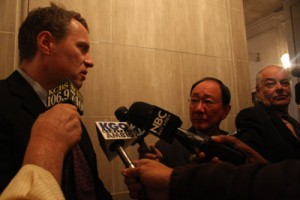 Gallagher, one of the few to speak against the item is surrounded my reporters.