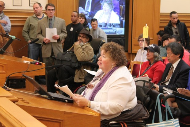 An advocate for disabled Muni riders speaks against the proposed fare increases for senior and disabled fast passes
