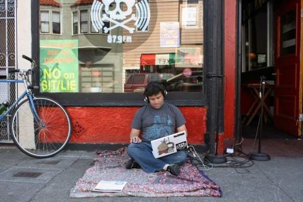"DJ Spider in front of Pirate Cat Radio on 21st street. On broadcasting from outside: ""I've met a lot of interesting people today."""