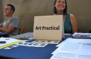 Art Practical copy chief Victoria Gannon enjoys a moment with a fellow publication representative.