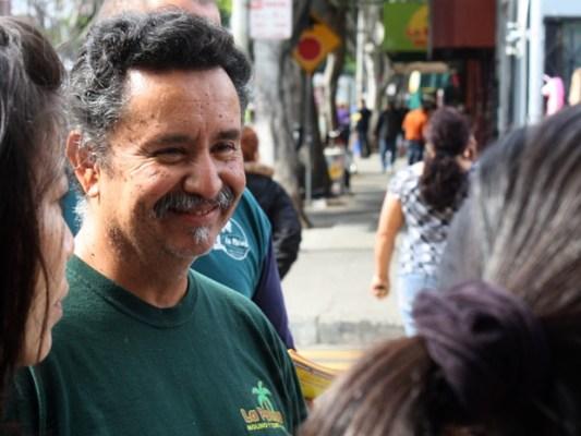 Francisco Casta, owner of La Palma Mexicatessen explaining the art of making tortilla masa.
