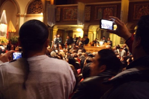 People shot video and photographs continually throughout the service.
