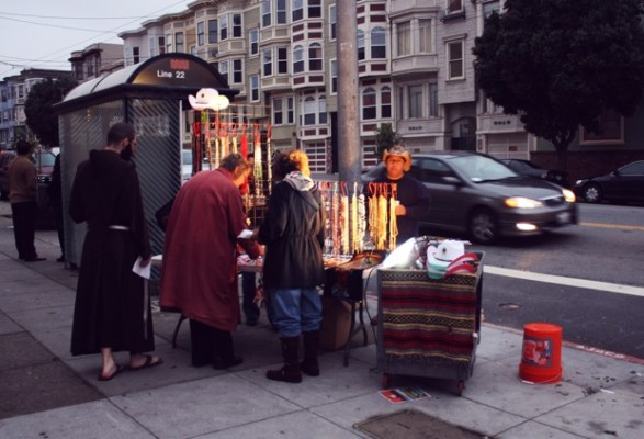 When the services let out around 7 a.m., this little stand was up and selling rosaries and cowboy hats.