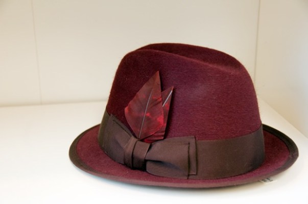 Burgundy felt fedora with feather by Tricia Roush at House of Nines at ADS Hats.