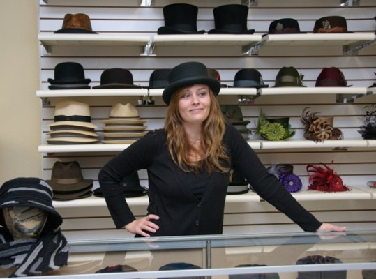 ADS Hats staff person Katie Friedman in a black felt bowler har by Tricia Roush of House of Nines.