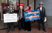 """Billionaires for Wealthcare"" confront demonstrators at Bank of America. Photo by Janis Lewin"