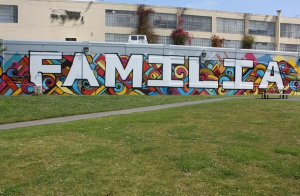 The Familia mural, painted behind the San Francisco General Hospital building by Victor Reyes, was unveiled today at Potrero Del Sol Park.