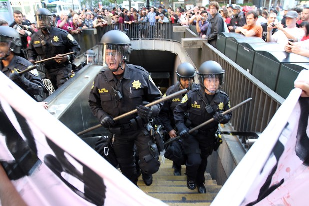 BART police officers block the entrance of Embarcadero Station after a stand off with protesters at the gate Photo by Nilanjan Nag