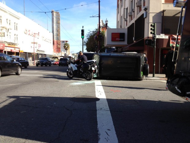 An overturned car on Mission Street near 22nd Street