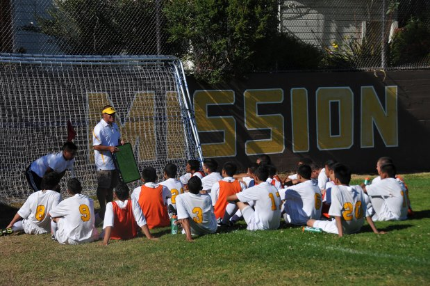 Mission High Soccer team at halftime. Photo by Helene Goupil.