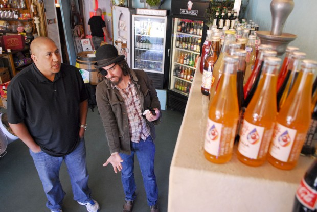 Customer and local restaurant owner Francisco Sanchez, left, speaks to Aaron Dolson co-owner of the Fizzary, which specializes in specialty soda. Photo by Sean Havey