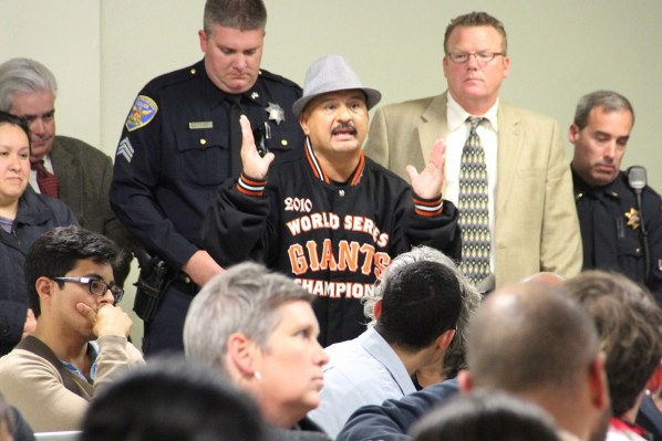 Roberto Hernandez addresses the crowd at the Good Samaritan Family Resource Center Monday night.