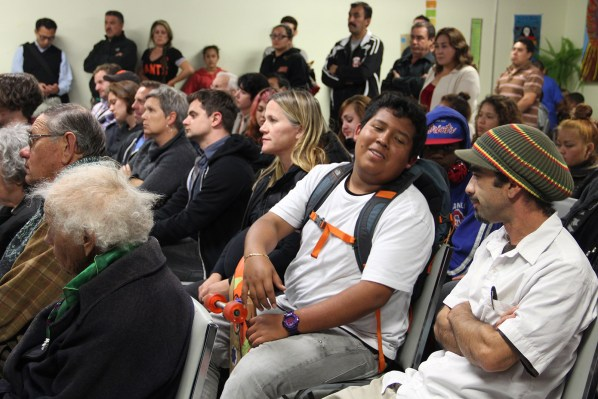 Audience members look on at the Good Samaritan Family Resource Center Monday night.