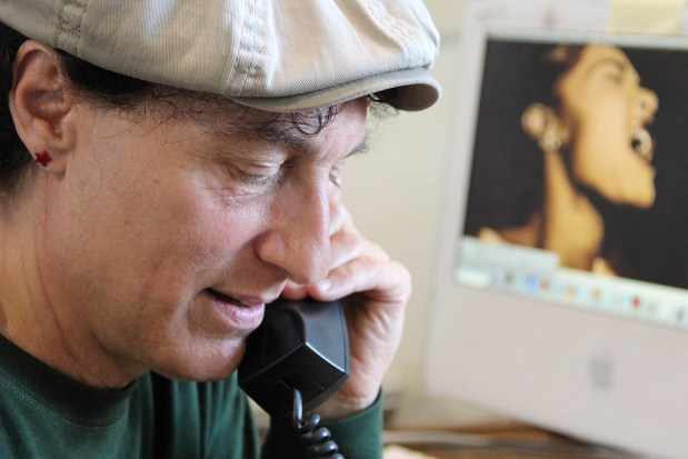 Tommi Avicolli Mecca, director of counseling for the Housing Rights Committee, takes a phone call.