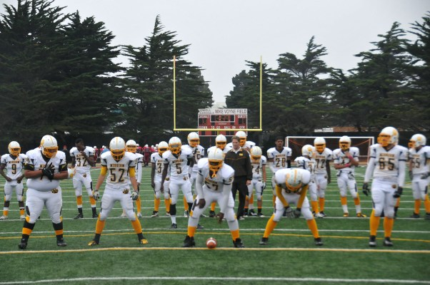The Mission Bears work on their formation before the game at Lowell Field.