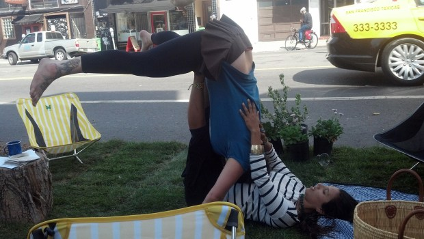 Human airplane rides were being offered on the grass of one pop-up parklet, next to a tepee and under homemade birdhouses.