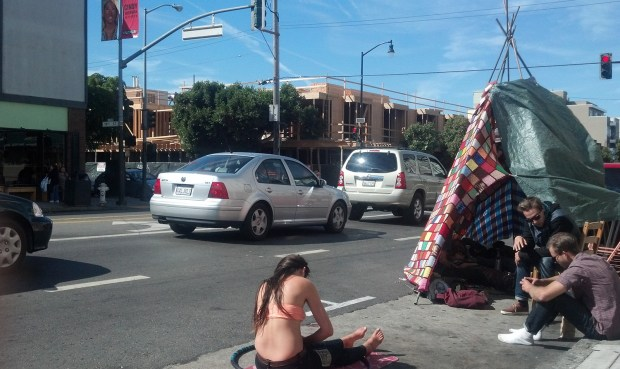 Ramsey Harvey and friends occupy a parking spot in front of Serendipity on Valencia Street.