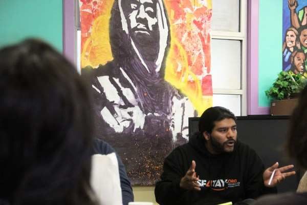 Conscious Youth Media member Jose-Luis Mejia talks to the Mission Peace Collaboration at the Mission Beacon Center.