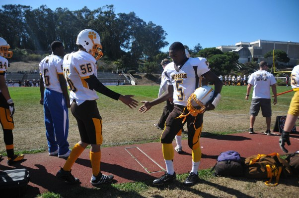 Mission High players encourage each other on the sideline.