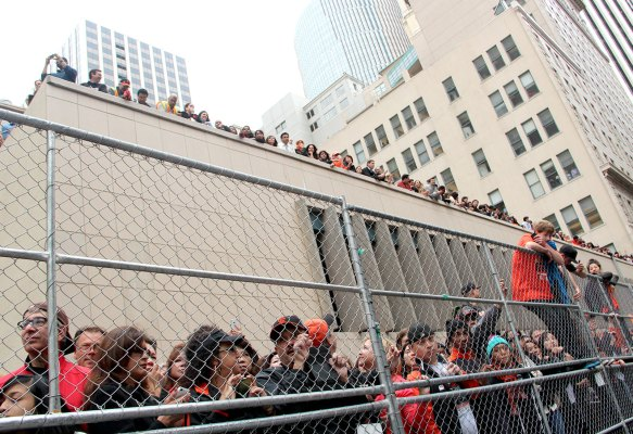Fans wait for the parade to start. Photo by Chelsi Moy.