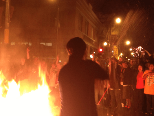 Revelers at 19th and Mission Streets. Photo by Mateo Hoke