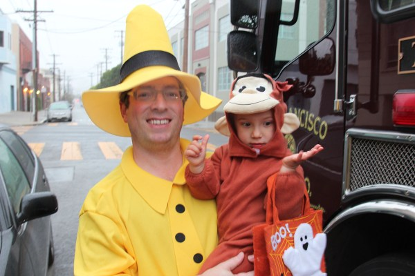 William and Suriya take a photo by the fire truck at the Shotwell St. Halloween Stroll. Photo by Alejandro B. Rosas