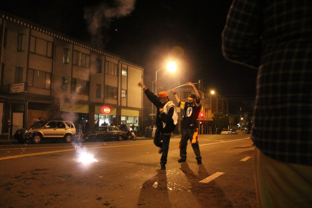 Fans celebrating after Game 4 of the World Series on Valencia St. outside the Phoenix Irish Bar. Photo by Erik Neumann