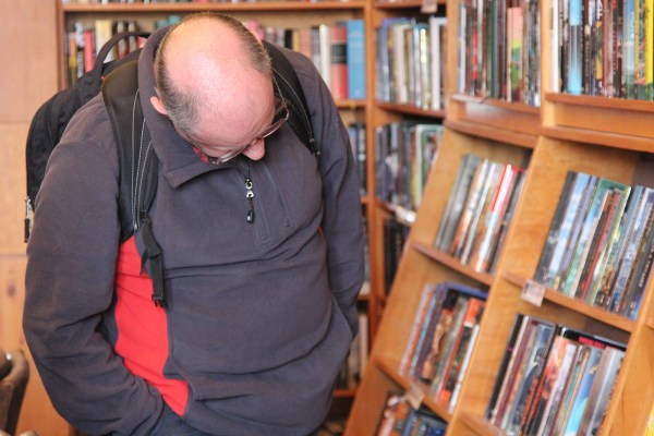A man browses through thousands of books on display at Borderlands Books.