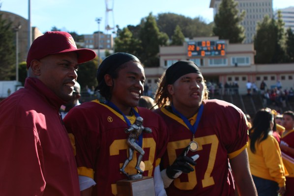 Jamani Holmes and Loesefa Leui of Lincoln High pose with the Turkey Day trophy after beating the Bears 22-21.