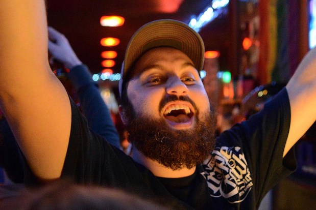 27-year old Ben Shapero reacts to CNN calling the election for President Obama while at El Rio. Photo by Sean Havey.