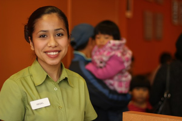 Abigail, a hostess at Pollo Campero on opening day. Photo by Claudia Escobar.